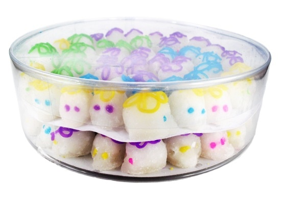 Picture of Miniature Sugar Candy Skulls in a plastic container box&nbsp;- Item No.&nbsp;10069-mini